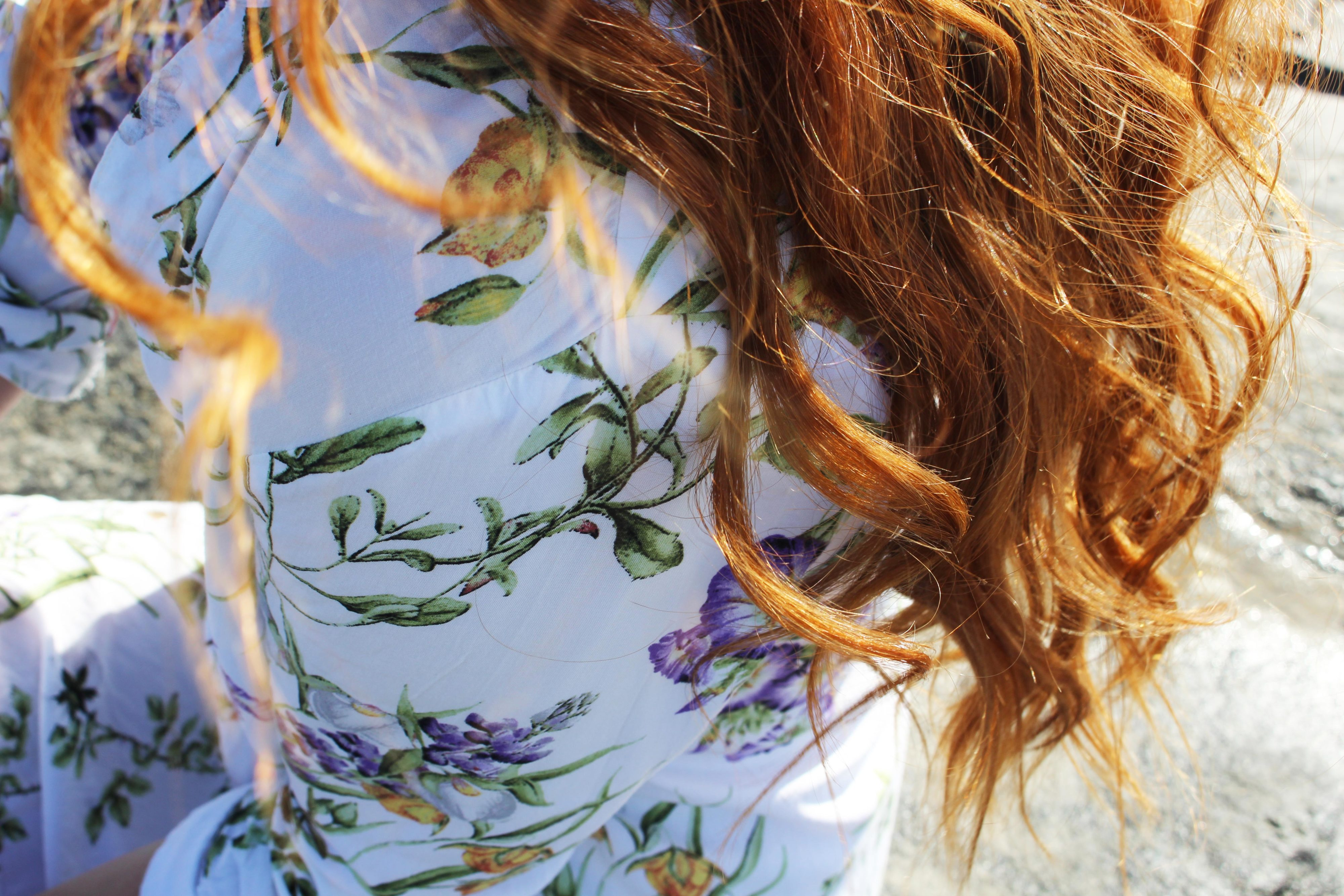 Redhead in floral H&M Dress close up