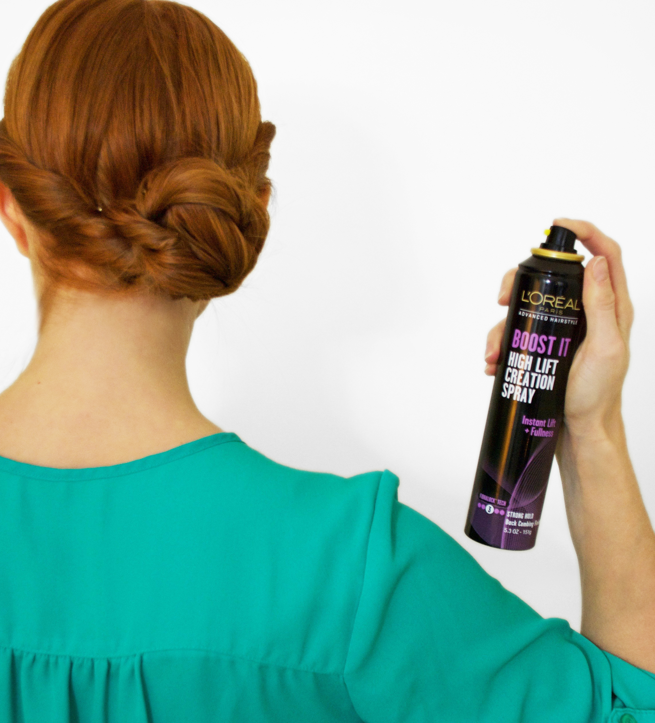 Redheaded girl using Loreal Boost It spray