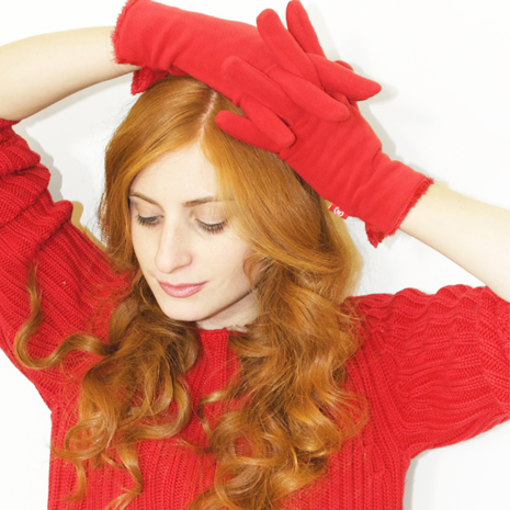 Redhead girl wearing red with red isotoner gloves on head