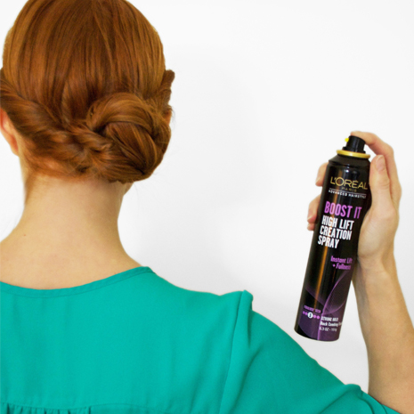 Girl using Loreal Boost It Spray