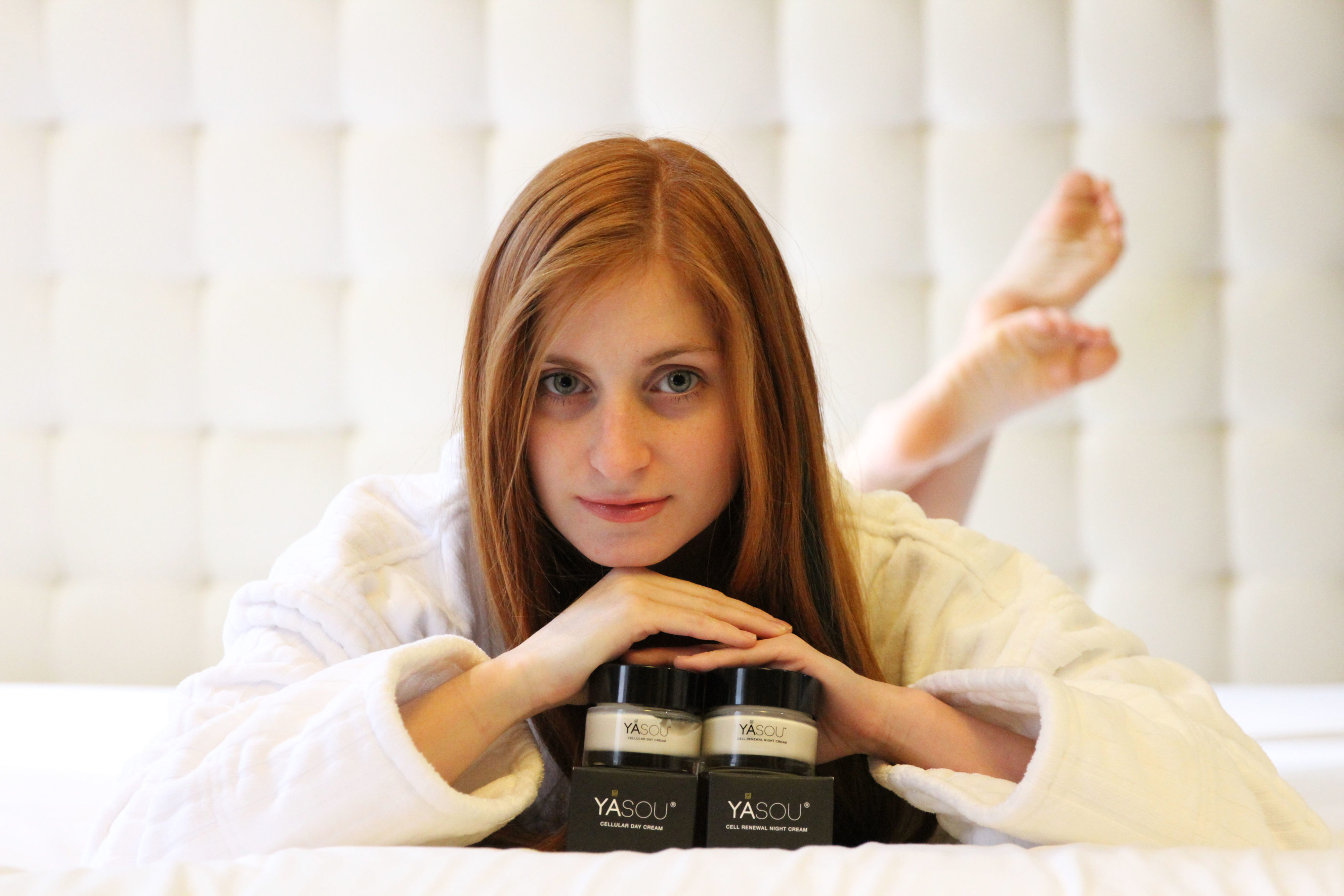 Redheaded Girl on bed with Yasou Skin Care Day and Night Cream