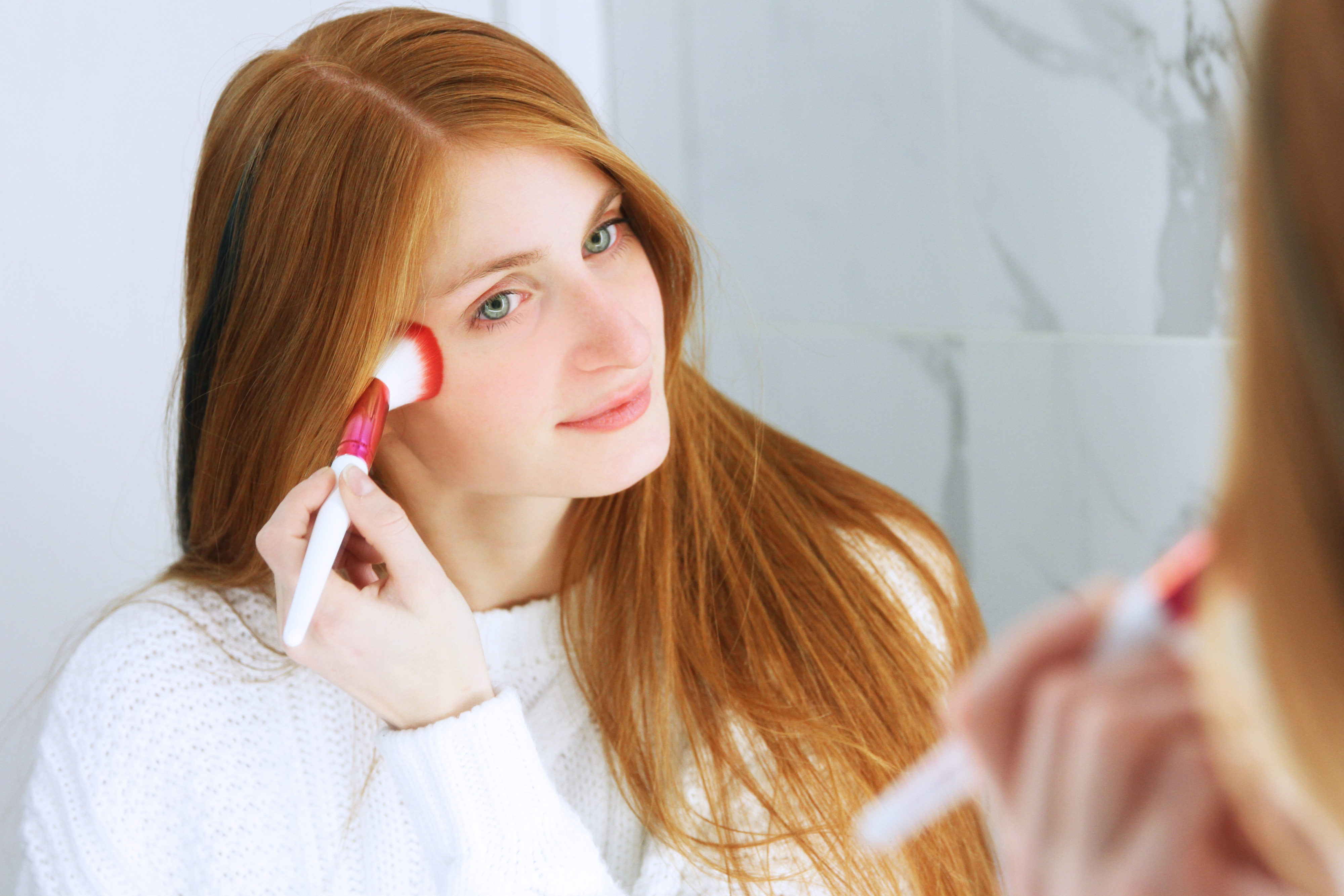Redhead woman using loella girl on fire brushes