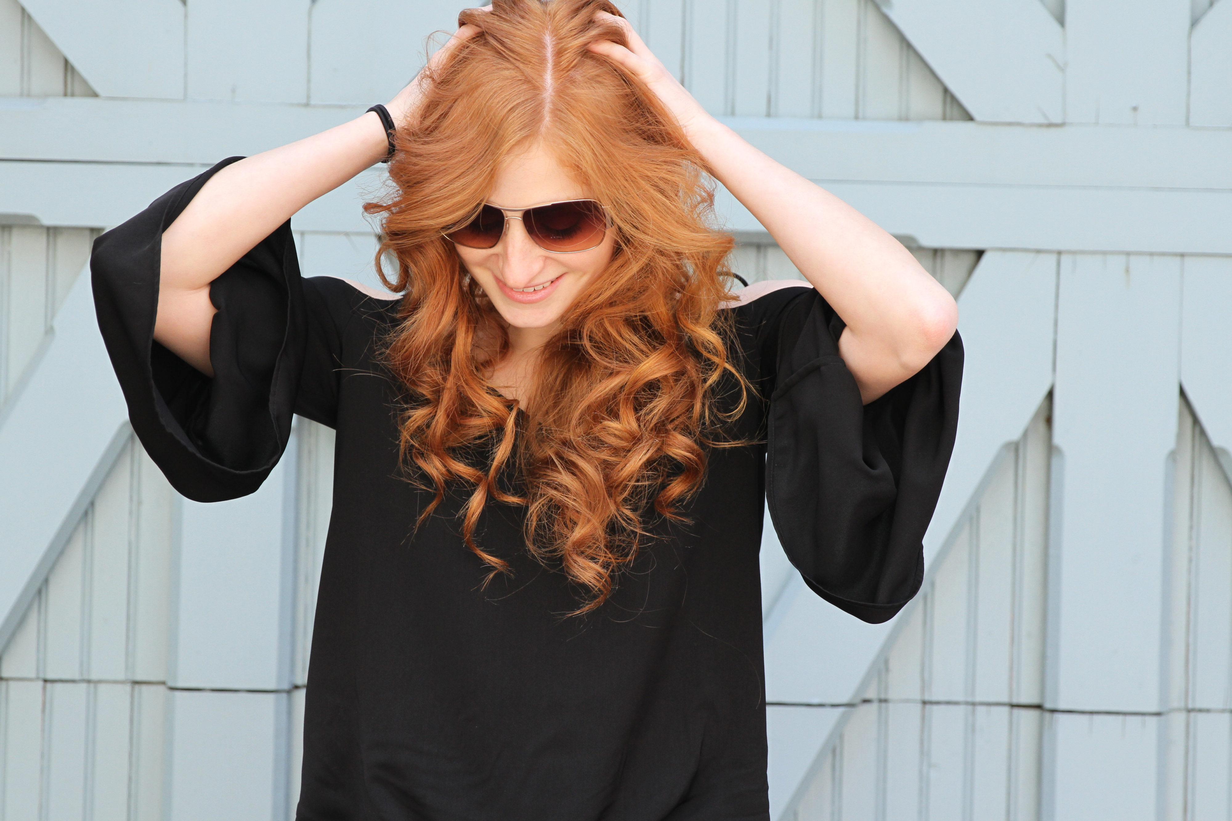 Erin Leigh She's Red haute Redhead smiling and looking down laid back in all black top