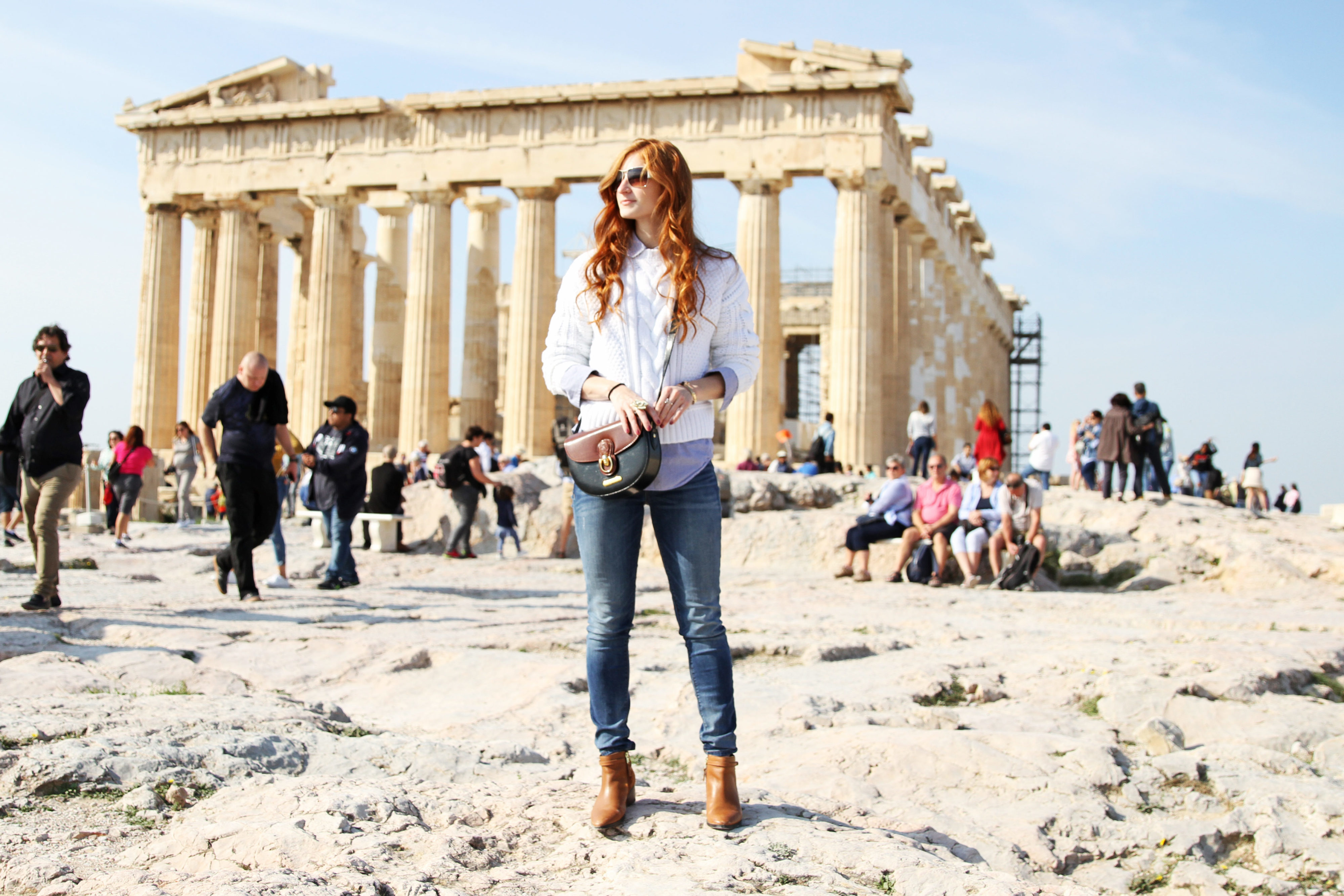 Redhead Erin Leigh standing in front of the Acropolis in Athens, Greece, She's Red Haute