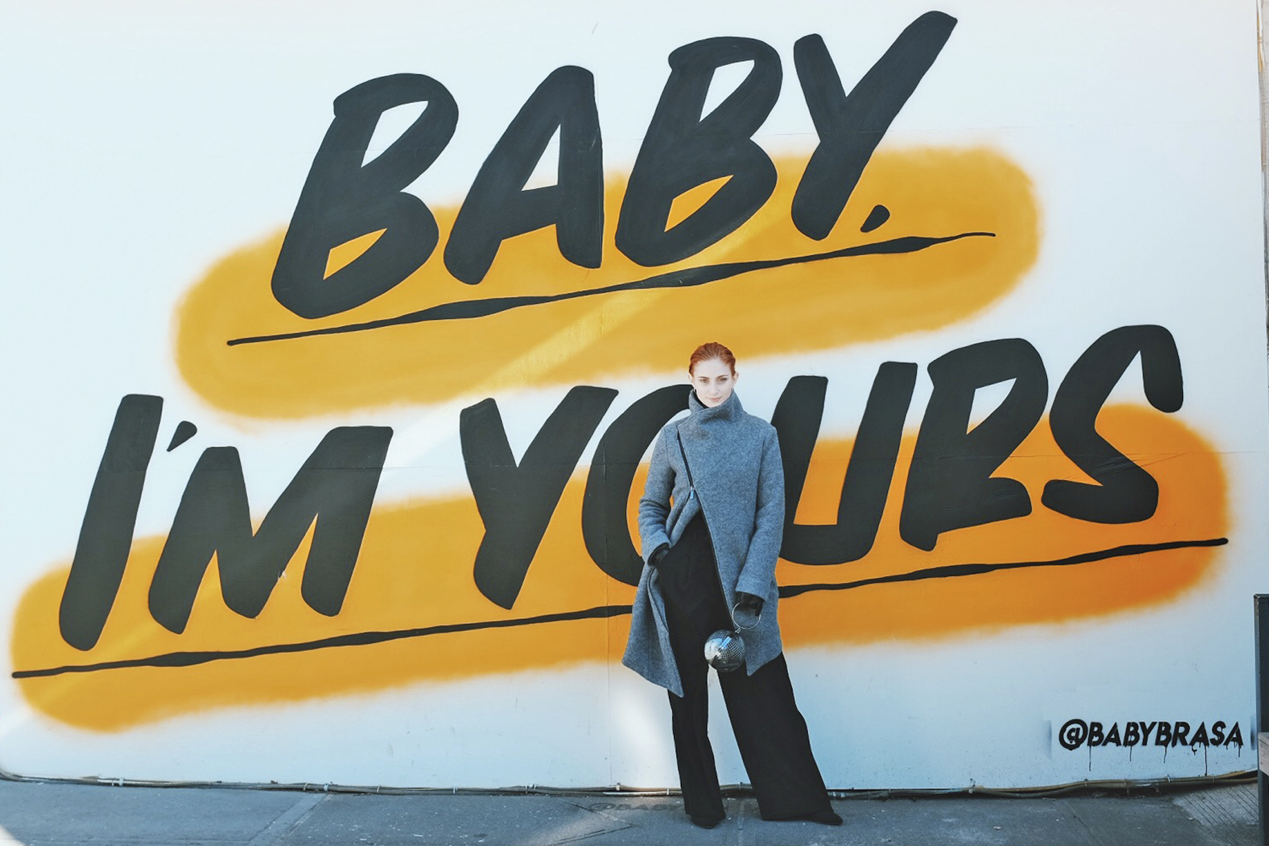 """Erin Leigh of She's Red Haute wearing marcella mode NYC in front of graffiti wall that says """"Baby I'm Yours"""""""