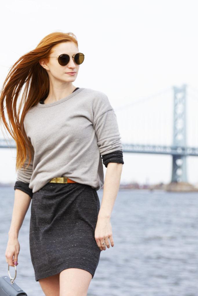 Erin Leigh of She's Red haute wearing Alternative Apparel standing in front of the Ben Franklin Bridge in Philadelphia