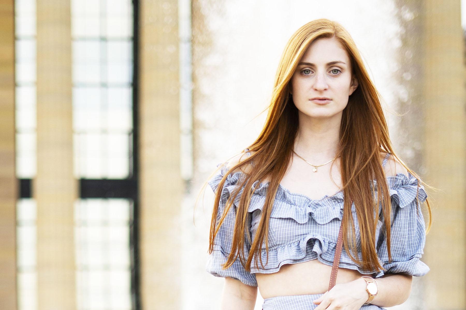 Ruffles,Erin Leigh of She's Red Haute redhead wearing blue ruffles Nasty Gal top