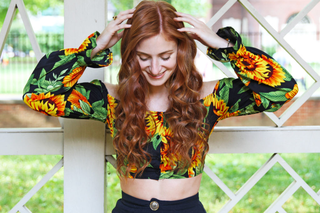 Erin of she's red haute wearing pretty little thing puff sleeve crop top and looking down