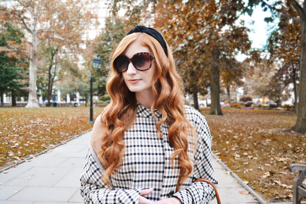 Redhead, She's red haute in a park in the fall wearing plaid