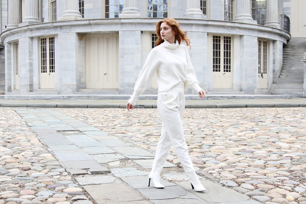 She's Red Haute Winter Whites, All white outfit on a redhead with white background