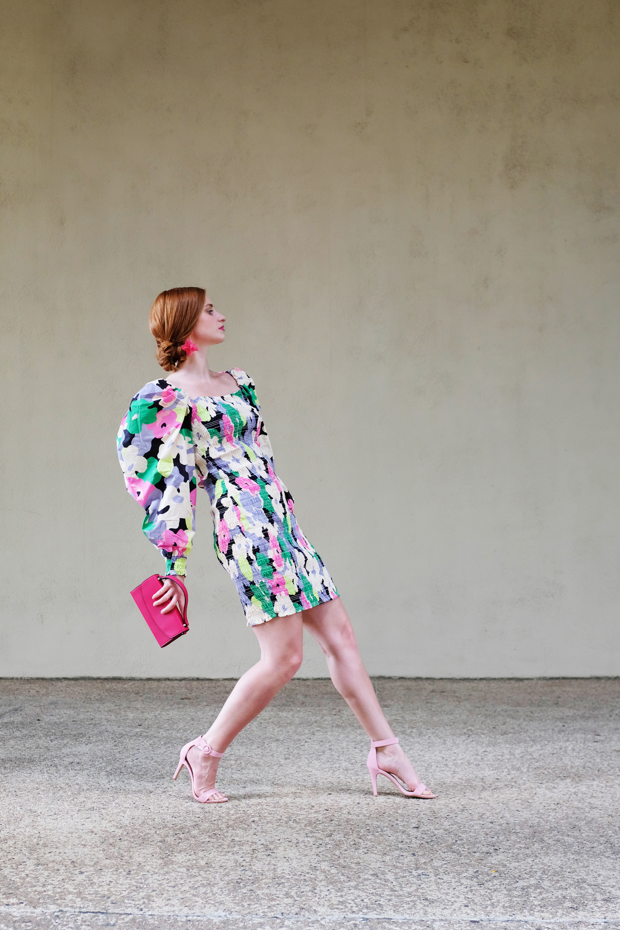 Erin of She's Red Haute wearing a floral puff sleeve dress