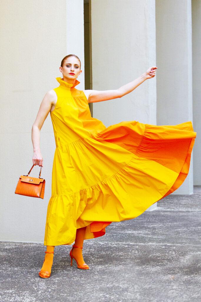 Redhead wearing yellow and orange dress, she's red haute